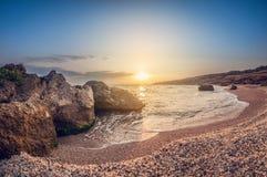 Beautiful landscape, sandy rocky bay at sunset, wild seashell beach stock image