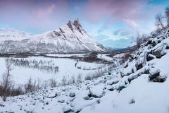 Beautiful landscape scene with Signaldalelva river and Otertinden mountain in background in Northern Norway . Sunset stock photos