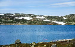 Beautiful landscape and scenery of Norway, the hills and mountain covered partially with white snow Stock Photos