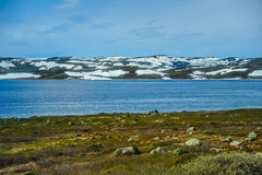 Beautiful landscape and scenery of Norway, the hills and mountain covered partially with white snow Royalty Free Stock Photography