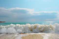 A beautiful landscape of the sea. The blue sea and the foamy waves on the shore royalty free stock photography