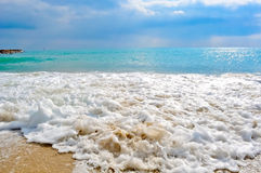 A beautiful landscape of the sea. The blue sea and the foamy waves on the shore stock photography