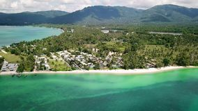 Beautiful landscape sea coast and beach on background tropical palms and hills. Aerial view. Luxury villa on sea island and tropical forest drone view stock video footage