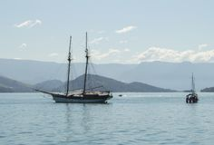 Beautiful landscape with sea and montains and boats. royalty free stock photo