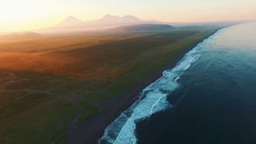 Beautiful landscape. The sea and mountains at sunset. Flying on the copter along the ocean waves stock video footage