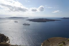 Beautiful landscape with sea views. Cruise ship in sea near NEA Kameni, a small Greek island in the Aegean sea near Santorini. Royalty Free Stock Photography