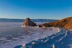 Beautiful sunset moment at Olkhon island,Russia. Beautiful landscape of Shaman rock during the sunset moment at Olkhon island in frozen Baikal lake,Siberia stock photo