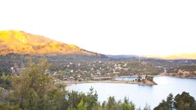 Tilt shift landscape of a small village next to a lake in the mountains royalty free stock photography