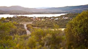 Tilt shift landscape of a little town next to a lake in the mountains royalty free stock photo