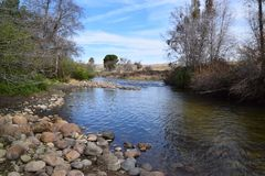Beautiful landscape that shows the transition of seasons, from winter to spring, Kern River, Bakersfield, CA. stock photos