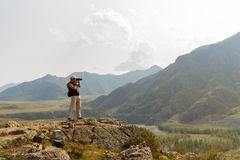 Beautiful landscape with the silhouette of photographer on backg Royalty Free Stock Photography