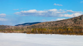 Beautiful landscape with ski run on frozen river Stock Photography