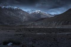 Beautiful landscape snow mountains at night on blue cloud background. Leh, Ladakh, India.  Stock Image