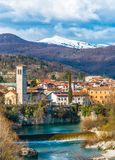 Beautiful landscape with snowy mountains, Italy. Beautiful landscape with snowy mountains, river and old Chapel in popular touristic medieval town Cividale del Stock Image