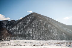 Beautiful Landscape of snowy winter greater Caucasus mountains. Sunny weather, trees clouds fields of Azerbaijan nature Stock Photos