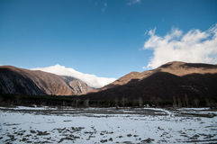 Beautiful Landscape of snowy winter greater Caucasus mountains. Sunny weather, trees clouds fields of Azerbaijan nature Stock Photo
