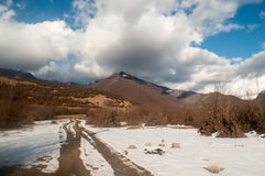 Beautiful Landscape of snowy winter greater Caucasus mountains. Sunny weather, trees clouds fields of Azerbaijan nature Stock Images