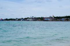 Beautiful landscape of some buildings in the horizont of Rocky Cay Beach in San Andres Colombia Royalty Free Stock Photos