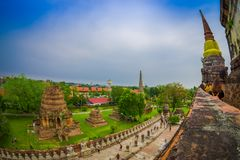 Beautiful landscape with some unidentified people walking at stupa ancient buddhist temple, famous and major tourist. Attraction religious of Ayutthaya Royalty Free Stock Photography