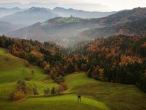 Beautiful landscape with St. Tomaz Church from Slovenia with fog stock image