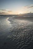 Beautiful landscape Summer sunset sky reflected on wet beach at Royalty Free Stock Photography