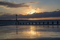 Beautiful landscape Summer sunset sky reflected on wet beach at Stock Photo