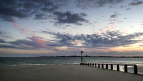 Beautiful landscape Summer sunset sky reflected on wet beach at Stock Image