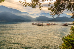 Beautiful Landscape of Sun Moon Lake in the morning with blue mo Stock Photos