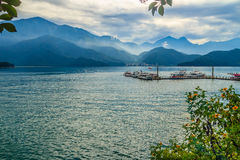 Beautiful Landscape of Sun Moon Lake in the morning with blue mo. Untain background at Nantou, Taiwan royalty free stock photo