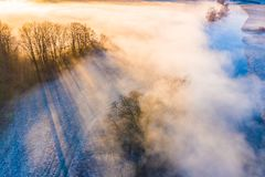 Beautiful landscape. Sun shining through thick fog aerial view.Rural scenery stock image