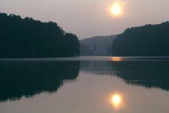 Beautiful landscape during sunrise on the lake Stock Photos