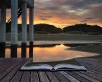 Beautiful landscape sunrise stilt lighthouse on beach conceptual Royalty Free Stock Image