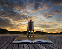 Beautiful landscape sunrise stilt lighthouse on beach conceptual Royalty Free Stock Images