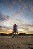 Beautiful landscape sunrise stilt lighthouse on beach Royalty Free Stock Images