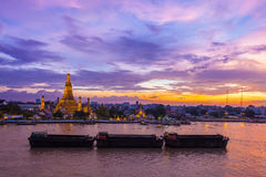 The beautiful landscape sunset of famous travel place Wat Pho with life sand boat foreground Royalty Free Stock Image