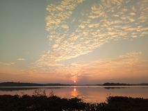 Beautiful landscape of sunset over the lake with reflexion. Thailand Stock Photos