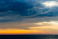 Beautiful landscape with sunset over sea with dramatic sky Royalty Free Stock Photography