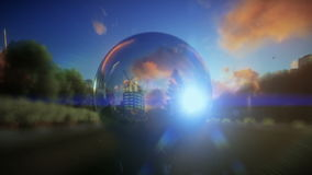 Beautiful landscape at sunset seen through a glass orb stock footage