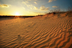 Beautiful Landscape with sunset sky and wavy sand. Stock Photo