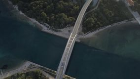 Beautiful landscape surrounded with blue sea with bridge between stock video footage