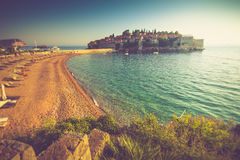 Beautiful Landscape of the Sveti Stefan island resort and beach at sunset. Montenegro. Royalty Free Stock Photos