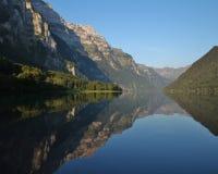 Summer morning at lake Klontalersee, Switzerland. Mountain range Royalty Free Stock Photography