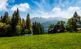 Beautiful landscape of Tatra Mountains. Location Zakopane village, Poland. lovely scenery with forest on a grassy meadow and a ridge under the gorgeous sky in Royalty Free Stock Photo