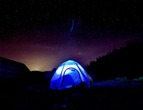 Beautiful landscape with a tent in the mountains against the sky royalty free stock photography