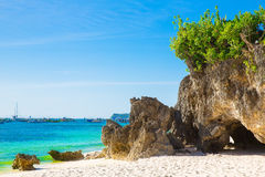 Beautiful landscape of tropical beach, rocks with vegetation, se Stock Photo