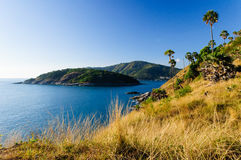 Beautiful Landscape and Tropical over the sea and Cape with blue sea, sky background and yellow grass foreground. Wide angle. Phromthep cape viewpoint at blue Stock Photography