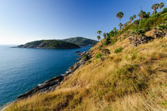 Beautiful Landscape and Tropical over the sea and Cape with blue sea, sky background and yellow grass foreground. Wide angle. Phromthep cape viewpoint at blue Royalty Free Stock Photography