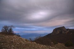 Beautiful Landscape on two mountains and cloud. Interst abstract cloud to blue  sky and sea background in evening in Black sea in Crimea Royalty Free Stock Photography