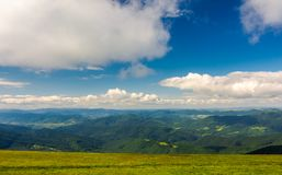 Beautiful landscape under the summer sky. Fluffy clouds over the mountain ridge. pleasant atmosphere and good day for a hike. lovely nature background Royalty Free Stock Photos