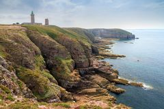 Coastline cliffs at Cap Fréhel. Beautiful landscape view of the coastline at Cap Fréhel in Brittany, France, with its lighthouses and steep cliffs in summer Stock Photo